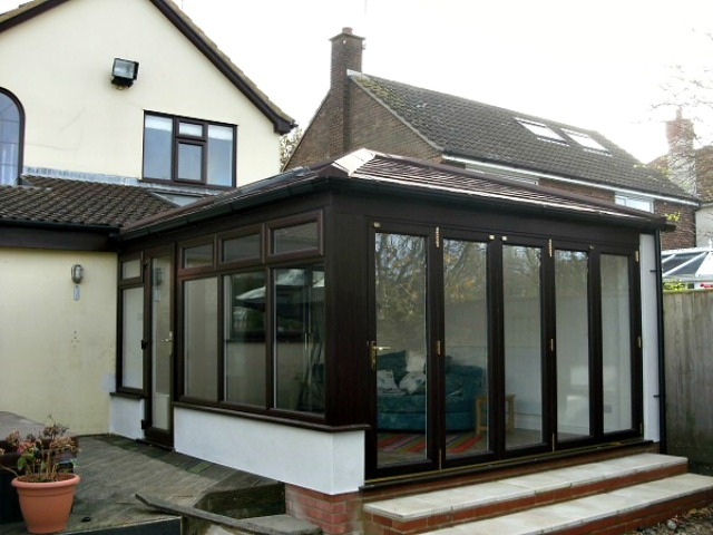 UPVC Conservatory with tiled roof & bi-fold doors