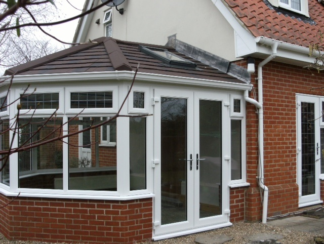 Conservatory with tiled roof, rooflight & French doors
