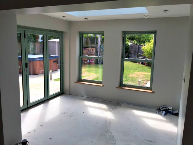 Orangeries with windows all around create a bright, welcoming space.