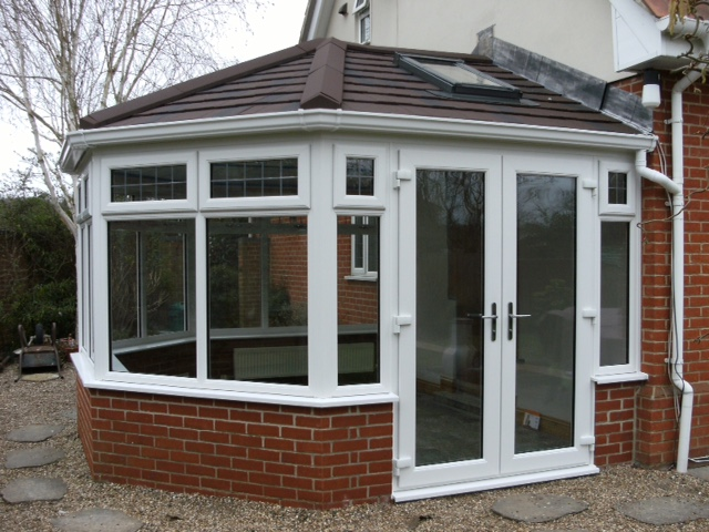 The same conservatory but with a new solid roof and Velux window