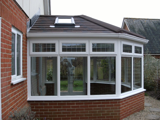 Conservatory roofs - tiled roof with Velux window